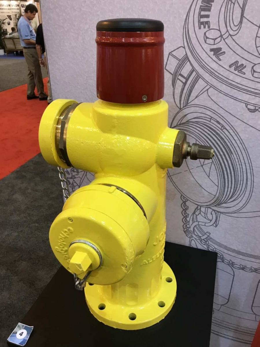 "The J-0438 wet-barrel ""smart"" fire hydrant with a pressure-monitoring dome and a fixed leak-detection cap."